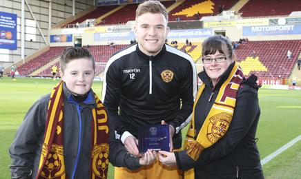 Fans present award to Cadden